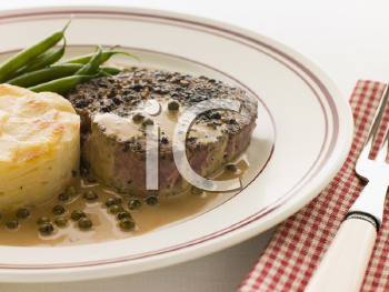 Royalty Free Photo of Filet Mignon au Poirve' with French Beans and Pomme Anna