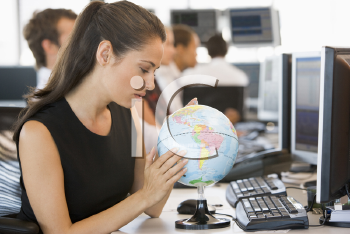 Royalty Free Photo of a People at Computers With a Globe on the Desk