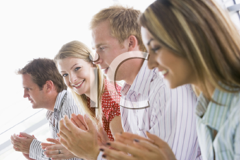 Royalty Free Photo of Four Young Businesspeople Applauding