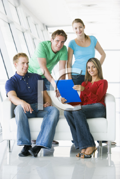 Royalty Free Photo of Four People With a Clipboard