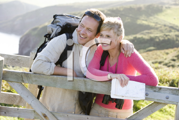 Royalty Free Photo of Hikers at a Fence