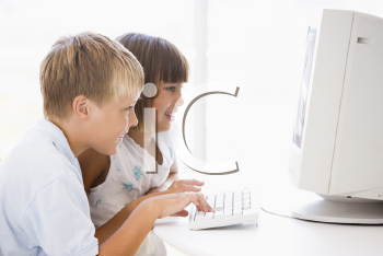 Royalty Free Photo of Two Children at the Computer