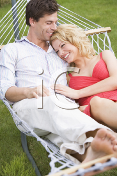 Royalty Free Photo of a Couple in a Hammock