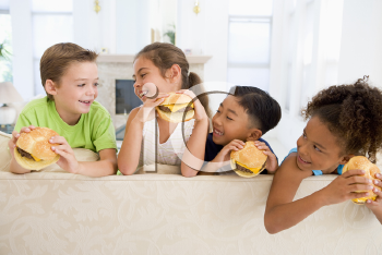 Royalty Free Photo of Children Eating Cheeseburgers