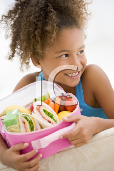 Royalty Free Photo of a Young Girl With Her Lunchbox