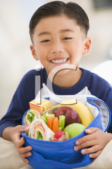 Royalty Free Photo of a Boy With a Lunchbox
