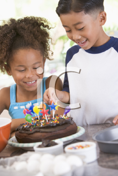 Royalty Free Photo of Two Children With a Birthday Cake
