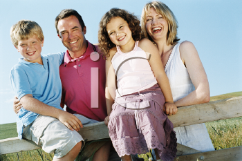 Royalty Free Photo of a Family at a Fence