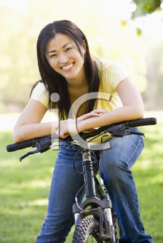 Royalty Free Photo of a Woman on a Bike