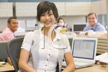 Royalty Free Photo of a Woman in an Office Cubicle