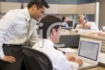 Royalty Free Photo of Two Men in an Office Cubicle