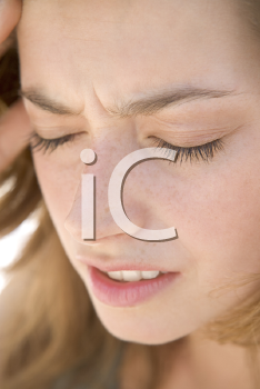 Royalty Free Photo of a Woman Holding Her Head