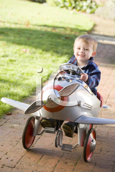 Royalty Free Photo of a Little Boy in a Toy Airplane