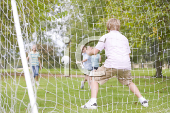 Royalty Free Photo of Kids Playing Soccer