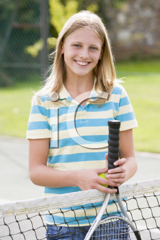 Royalty Free Photo of a Girl on a Tennis Court