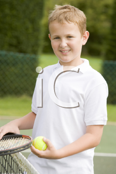 Royalty Free Photo of a Boy With a Tennis Racket