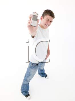 Teenage boy holding up cellular phone and smiling