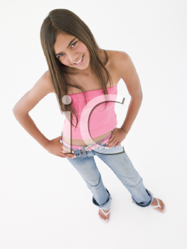 Young girl standing with hands on hips smiling