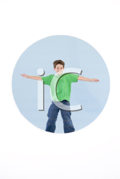 Royalty Free Photo of a Boy Jumping With His Arms Out