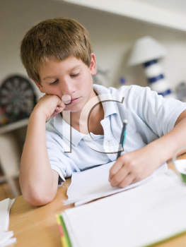 Royalty Free Photo of a Boy Doing Homework in His Room