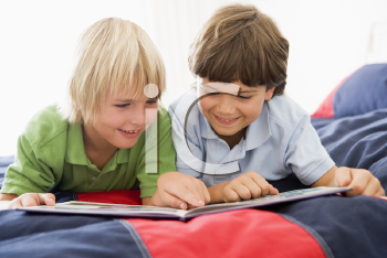 Royalty Free Photo of Two Boys Reading a Book