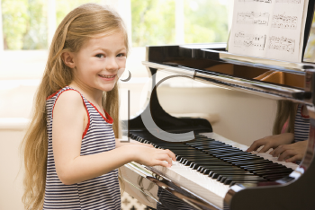 Royalty Free Photo of a Girl Playing Piano