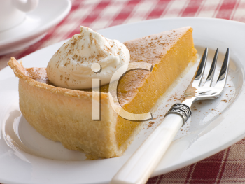Royalty Free Photo of Pumpkin Pie and Whipped Cream