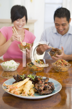 Royalty Free Photo of a Couple Eating Chinese Food