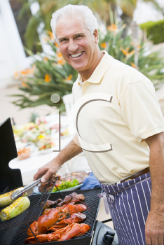 Royalty Free Photo of a Man Barbecuing