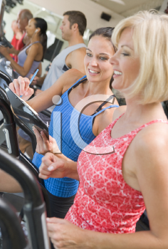 Royalty Free Photo of a Personal Trainer With a Woman on a Treadmill