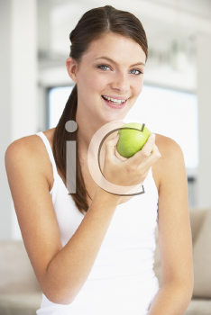 Royalty Free Photo of a Young Woman Eating a Granny Smith Apple