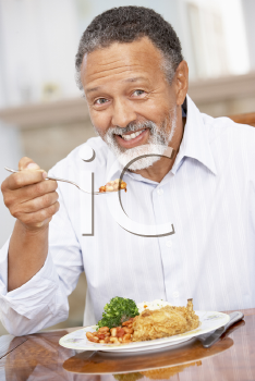 Royalty Free Photo of a Man Enjoying a Meal