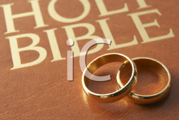 Royalty Free Photo of Wedding Rings on a Bible