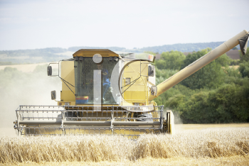 Royalty Free Photo of Harvester in a Field