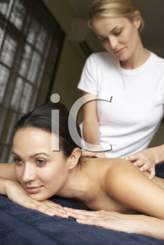 Royalty Free Photo of a Woman Having a Massage
