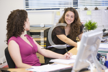 Royalty Free Photo of Two Women at Desks