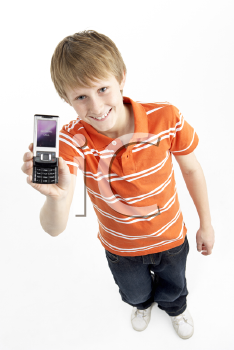 Royalty Free Photo of a Young Boy With a Cellphone