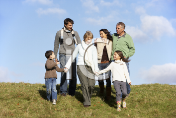 Royalty Free Photo of a Family Walking in a Park