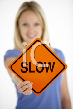 Royalty Free Photo of a Woman Holding a Sign That Says Slow