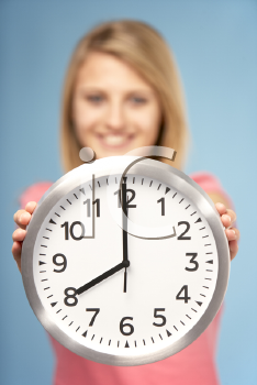 Royalty Free Photo of a Girl With a Clock