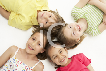 Royalty Free Photo of Four Children With Their Heads in a Circle