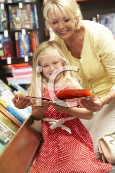 Royalty Free Photo of a Grandmother and Granddaughter in a Bookstore