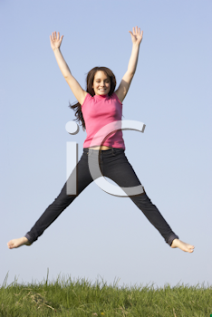 Royalty Free Photo of a Jumping Girl Outside