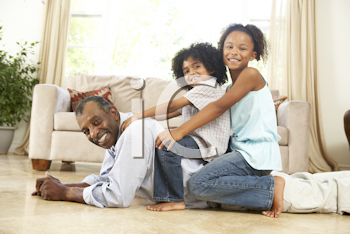 Royalty Free Photo of a Man on the Floor With His Grandchildren