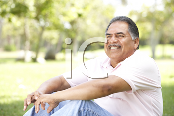 Royalty Free Photo of a Man Sitting Outside