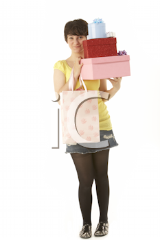 Studio Portrait Of Teenage Girl Carrying Packages And Shopping Bags