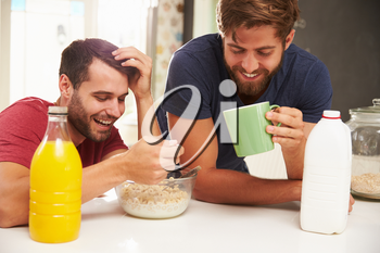 Two Male Friends Enjoying Breakfast At Home Together