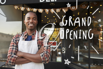 Black male business owner outside coffee shop grand opening