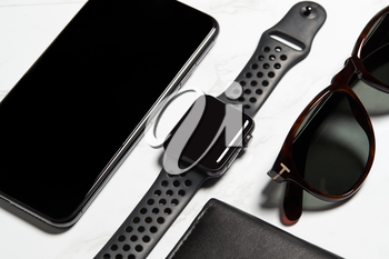 Flat Lay Shot Of Techno Items For Modern Worker With Smartwatch Mobile Phone And Sunglasses
