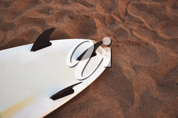 Close Up Of Underside Of Surfboard Lying On Sand